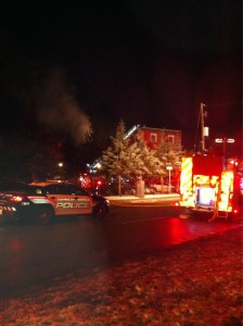 Fire crews and police respond to Saturday night's fire at 57 Bridgeport Rd. (Photo by Elizabeth DiCesare).