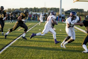 Running back Dillon Campbell rushes in his first touchdown of the night. (Photo by Dillon Campbell)