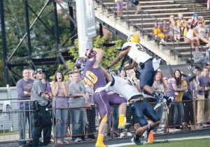 Anthony Pizzuti makes a catch in the endzone that was ruled out of bounds during Saturday's 26-25 loss. (Photo by Rosalie Eid)