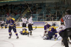 Laurier celebrates a goal against the Nipissing Lakers (in purple) Friday night. (Photo by Ryan Hueglin)