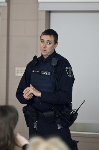 Constable Andrew Sharen of the Waterloo Regional Police Service speaks to community members. (Photo by Will Huang)