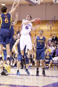 Will Coulthard goes for a layup during Friday's game against Queen's. (Photo by Heather Davidson)