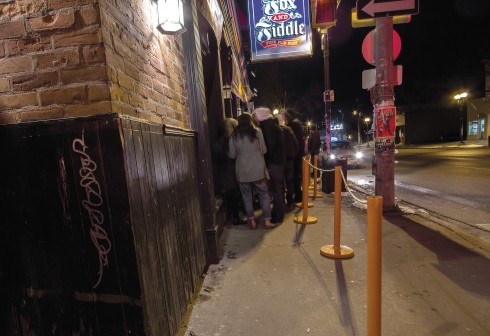 Students are increasingly finding that they're waiting in line longer at bars and clubs. (Photo by Heather Davidson)