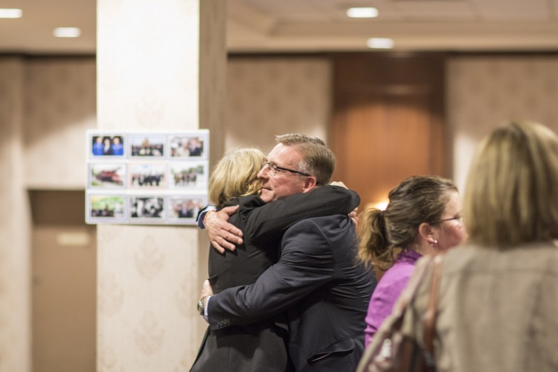 Conservative candidate Peter Braid hugs NDP candidate Diane Freeman at Braid's headquarters on Monday night (Will Huang/Photo Editor).