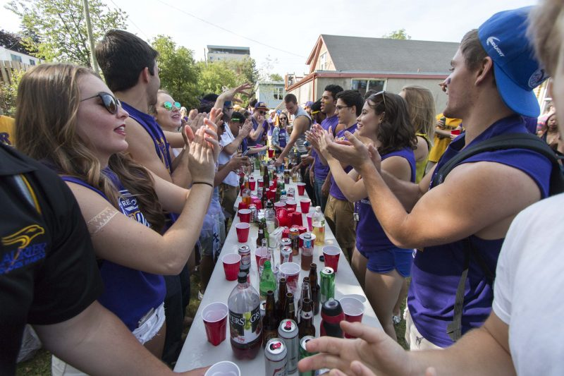 Students play a game of flip cup during Homecoming festivities. Photo by Jessica Dik