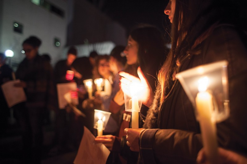 A candlelight vigil took place at the quad to commemorate the lives lost from this week's tragic events (Jessika Dik/Lead Photographer).