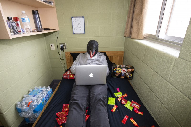A staged photo portraying how students who decide to stay in during halloween can find enjoyment without social interaction or partying. (photo by Marco Pedri/Staff Photographer)