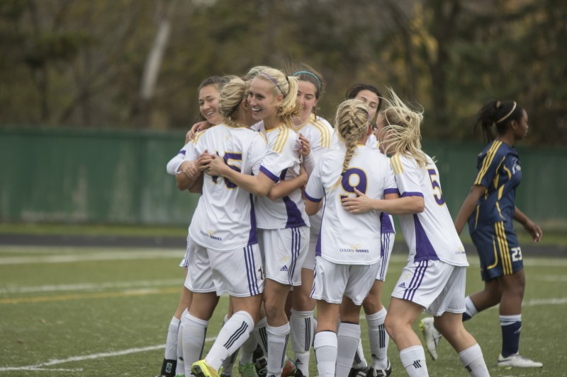 Fifth-year Emily Brown celebrates with her women's soccer teammates after she scored the game-winning goal in the quarter-final playoff game (Shelby Blackley/Editor-In-Chief)